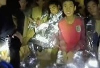 Rescued Thai football boys pray at Buddhist temple as they begin first day back home