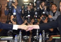 The Latest: Rival Koreas to meet in Pyongyang; date not set