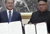 The Latest: Koreas agree to seek to co-host 2032 Olympics