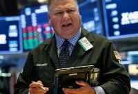 Banks lift S&P, Dow; Nasdaq weighed by Microsoft
