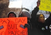 Government workers tighten belts, brace for first missing paychecks during shutdown