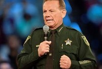 Florida governor suspends sheriff for response to school massacre