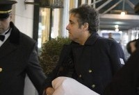 Michael Cohen seen clutching pillow with arm in sling as reports say Trump ordered him to lie to ...