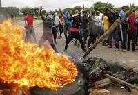 The Latest: Zimbabwe president returns to address crisis