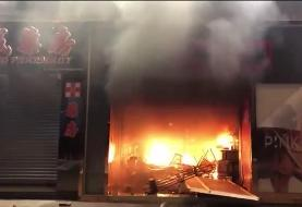 Hong Kong: Protesters set fire to business in Mong Kok area