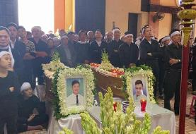 Vietnamese village holds funeral for trafficking victims