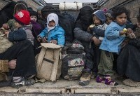 Trucks carrying women, children leave IS Syria redoubt