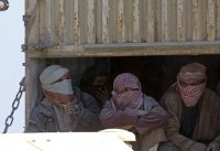 Convoy plucks women, children from last IS holdout in Syria