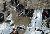 Migrants sleep on ground, rig awnings at Texas Border Patrol station