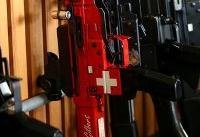 Swiss voters approve tighter gun control, avoid EU clash