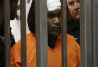 The Latest: Suspect in police killing wears bandage to court