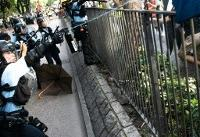 Clashes as Hong Kong protesters vent at China border traders