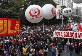 Tens of thousands of women march against Bolsonaro in Brazil