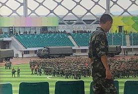 Chinese military personnel parade near Hong Kong border: AFP