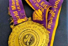 بانوی قهرمان ورامینی مدال جهانی خود را به مسجد جمکران اهدا کرد