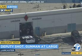 The Latest: Shooter at large after LA deputy shot at station
