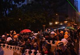 Hong Kong police disperse brick-throwing protesters