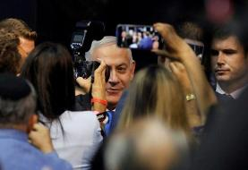 Israel in suspense after exit polls show tight race