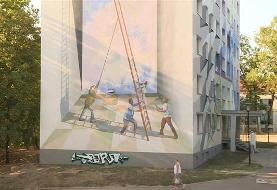 Giant art project transforms eastern Germany housing blocks