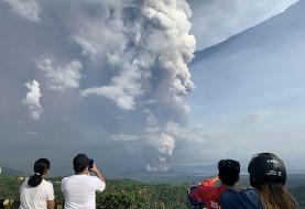 Ash pours from Philippine volcano, halting flights