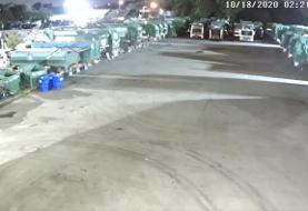 Watch a man in a garbage bag 'suit' set fire to garbage trucks at Broward waste center