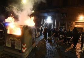 Hundreds of protesters clash with police over coronavirus restrictions in Naples