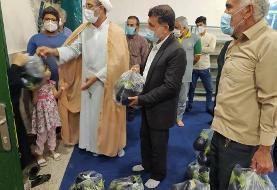 ماجرای تصاویر جنجالی توزیع بادمجان توسط یک امام جمعه