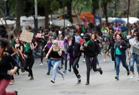 Mexican demonstrators splash presidential palace red in protest over murder of women