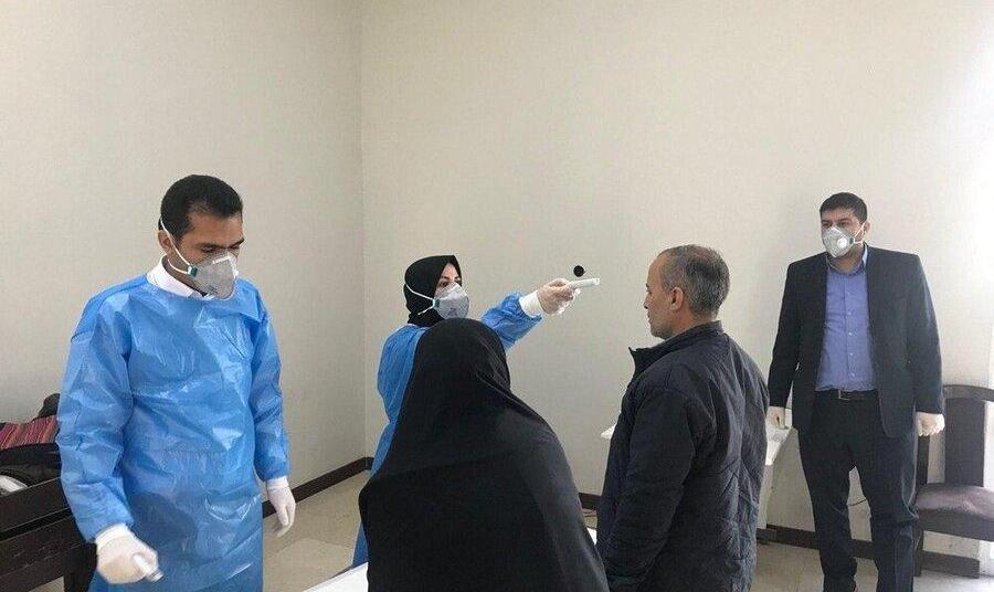 عکس: کنترل دمای بدن نمایندگان! تست ویروس کرونا در ورودیهای مجلس
