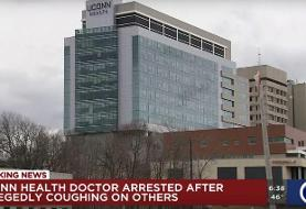 A Connecticut doctor has been charged after authorities said he deliberately coughed on his ...