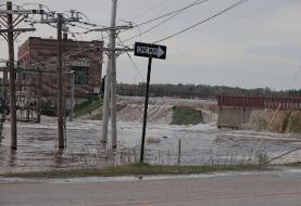 Photos and videos show the destruction after 2 dams collapsed in Michigan, threatening a town ...