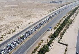 عکس روز | صف کیلومتری خودروها در بزرگراه دوبی به ابوظبی