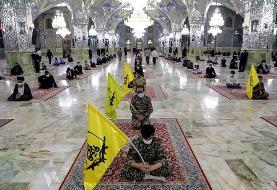 (تصاویر) تشییع پیکر شهید نسیم افغانی در حرم رضوی