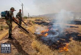 ویدئو / مانور آتشسوزی کنترلشده در علفزارهای قم