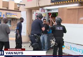 TV reporter tries to stop LA police arresting black store owners and good Samaritans instead of ...