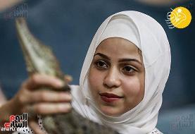 (تصاویر) دختر ۱۵ ساله تمساح پرورش میدهد!