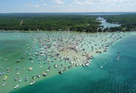 Michigan partygoers test positive for COVID-19 after July 4th lake bash; 43 cases tied to house ...