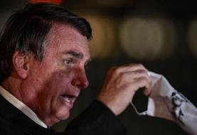 Brazil: Bolsonaro reportedly uses homophobic slur to mock masks