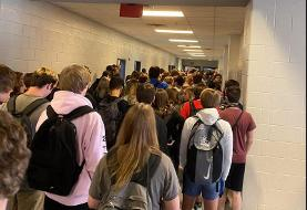 Photos of mask-less students crammed into a Georgia school hallway show how difficult reopenings ...