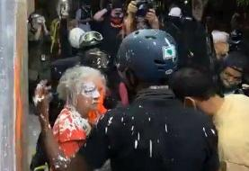Woman confronting vandals covered in paint during renewed Portland protests
