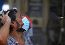 (تصاویر) دوشِ خیابانی برای مقابله با گرما در بغداد