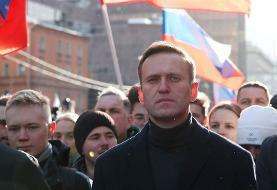 Putin opponent Navalny posts photo from hospital, plans to return to Russia