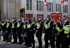 اعتراض به قوانین قرنطینه در لندن (+عکس) / ۳۲ نفر بازداشت شدند