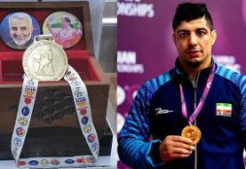 اهدای مدال آزادکار  تیم ملی کشتی به شهدای سوادکوه