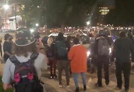 ببینید | پلیس سیاتل با دوچرخه از روی سر یک معترض عبور کرد