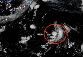 New tropical depression swirls in the West Pacific