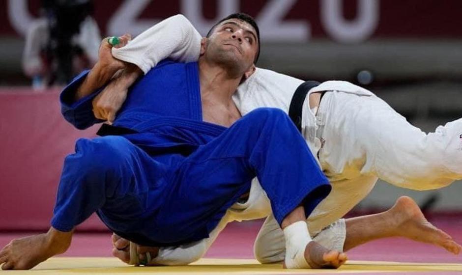 سعید مولایی با پرچم مغولستان به مدال نقره المپیک رسید